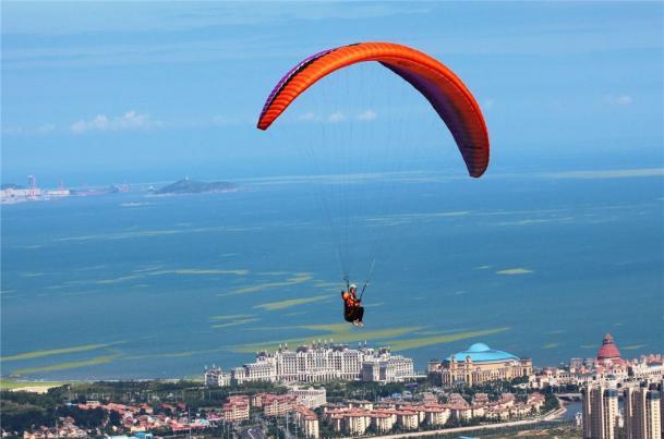 A person parasailing on a parachute
