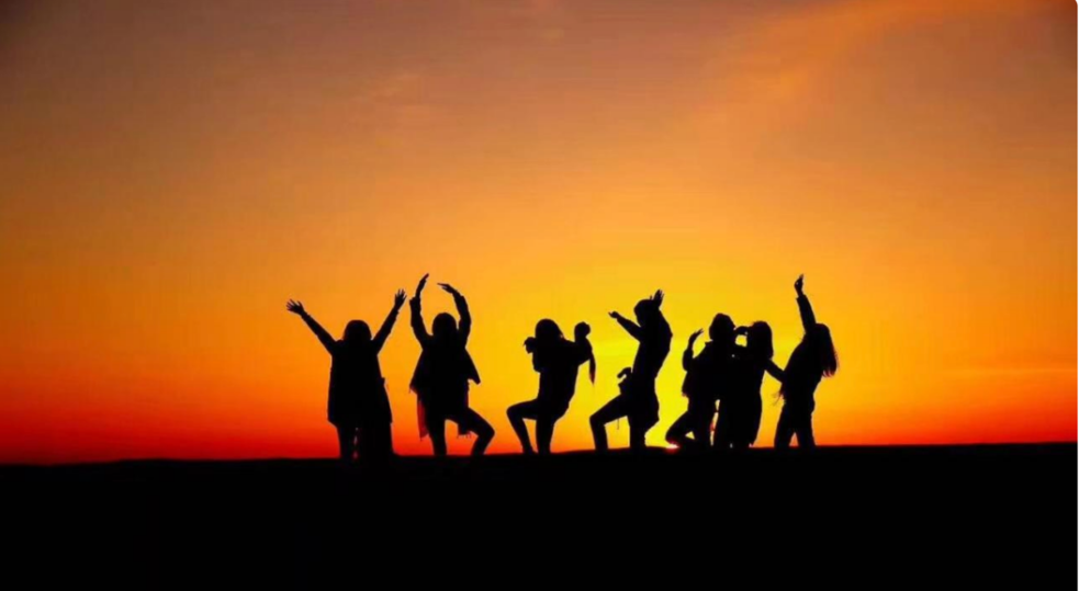 A group of people holding their hands up in the air Description automatically generated with medium confidence