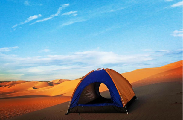 A tent in the desert Description automatically generated with low confidence